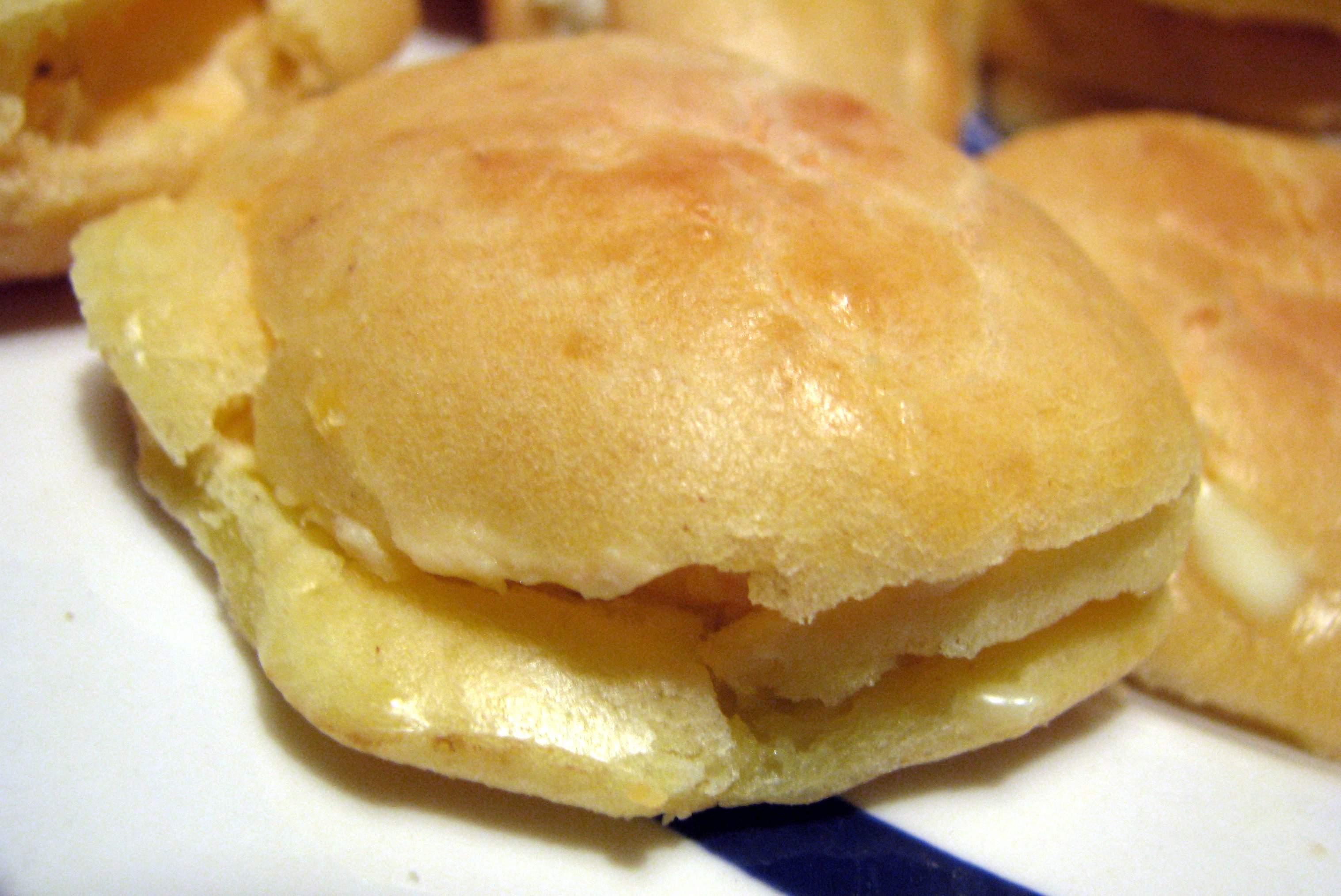 small round pastry with melted cheese inside